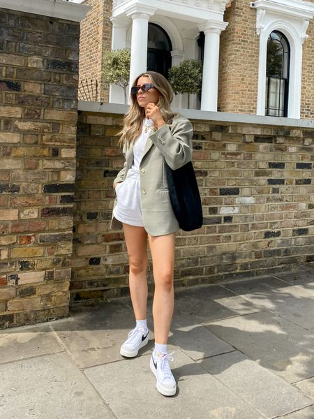 Love this oversized blazer layered over a T-shirt and a pair of jogger shorts for a smart casual look   I've finished off the look with my Nike blazers & a black slouchy bag     #LTKeurope
