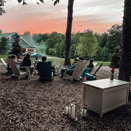 """Cheers to this pretty sunset over the weekend, bonfire nights with good friends, and catching fireflies. But mostly cheers to putting this retired toy box in the forest because having a """"forest toy box"""" for bonfire storage is so clutch 😂👌🏻 these are the innovations of 2021, guys!   #liketkit @liketoknow.it http://liketk.it/3jMam #LTKhome"""