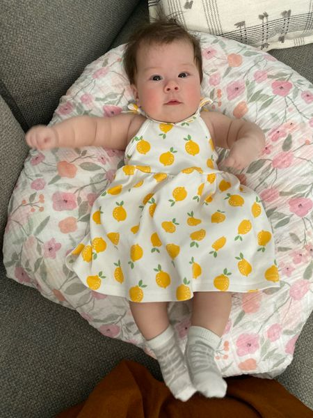 My lemon girl on her Boppy Newborn Lounger. She likes it a lot more than the Snuggle Me Lounger and it's a fraction of the price. We got the Big Blooms pattern and I covered it with an Aden and Anais swaddle for easy cleaning.   #LTKbaby