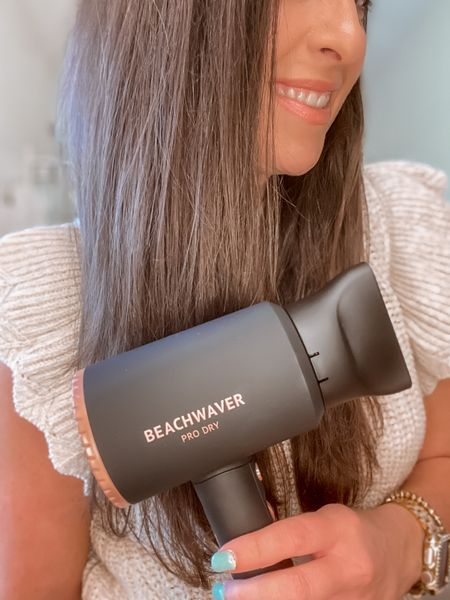 Let's talk about blowouts!   Love that my FAVORITE hair styling tool company, @thebeachwaver ,  now carries a Hair Dryer!  The Pro Dry in Midnight Rose is lightweight, with ion technology to leave hair smooth & silky. It's sleek and SO easy to use with removable precision nozzle, to keep frizz at bay!  Plus it's on MAJOR sale...30% off...only $104!  Now off to dry my hair ✋🏻    You can shop the rest of my looks one of these easy ways!  1️⃣ Click the link in my Profile 2️⃣ DM me for any links 💕 3️⃣ Screenshot a look for the @liketoknow.it app 4️⃣ Follow me @stephstyle101 on the FREE @liketoknow.it app to get all the shopping details of this outfit and all my other outfits.   . . . #beachwaves #brunette #blowdry #blowdrybar #blowout #cincinnatiblowout #beachwaverblowout #cincygram #cincinnatihair #beachwaverprodry #beachwaver #beachwaverambaasador  #classicblowout @beachwaverbabes #styletip #Thursmommaz #brunettebabe #beachwaveshair #reelsinstagram #brunettesofinstagram #hairinspiration #hairinstagram #hairstyleoftheday #affordablehair #easyhairstyle #getmylook  #LTKbeauty #LTKhome #LTKsalealert