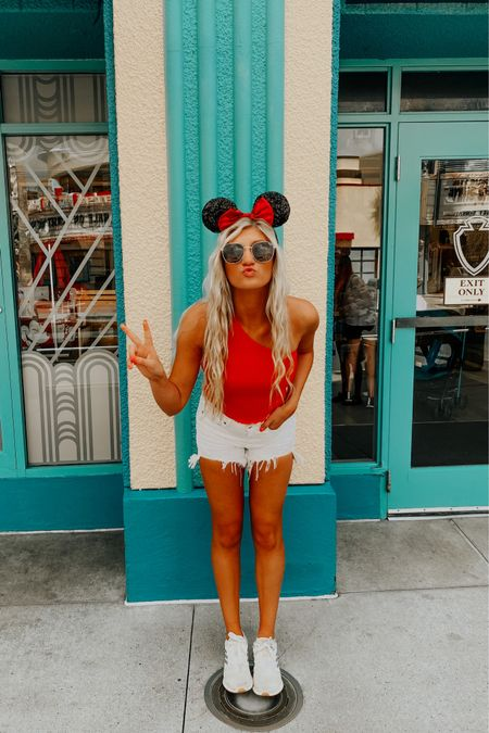 fourth of july + disney outfit⭐️ red crop top, white denim shorts, and comfy tennis shoes http://liketk.it/3hcQm #liketkit @liketoknow.it Shop your screenshot of this pic with the LIKEtoKNOW.it shopping app