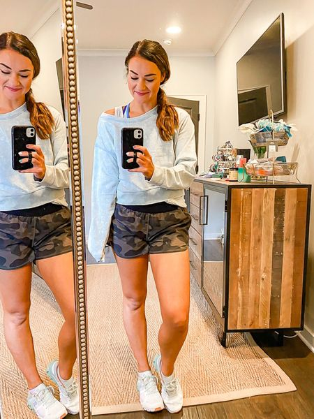 Crop sweatshirt for fall! Size S - TTS paired with camo shorts make a great layering outfit from the gym to errands. Sports bra and tank layered underneath take this athleisure look to the next level.  #LTKunder50 #LTKfit