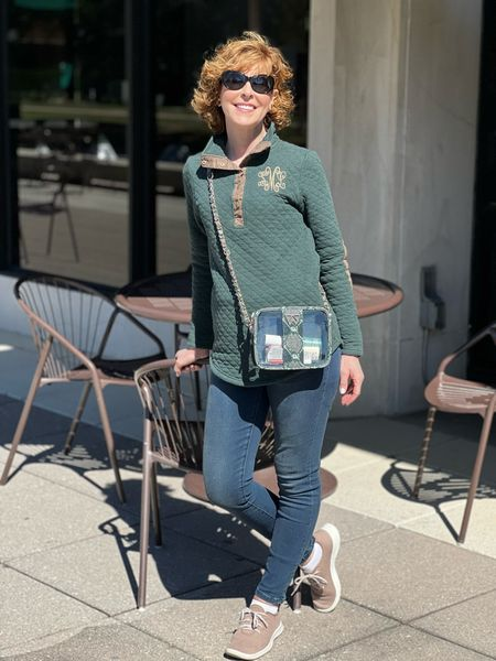 Clear bag, Gameday bag, Green pullover, Monogrammed pullover, elbow patch pullover, denim leggings, tan sneakers  This cute Kelly Wynne Mini Mingle gameday bag is super classy! Okay paired it with this fun monogrammed pullover for a gameday look that got lots of compliments!  #LTKstyletip #LTKSeasonal #LTKitbag