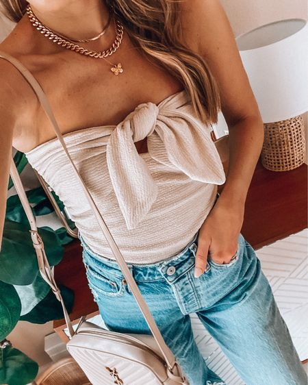 Bow tube top and dad jeans💕 Wearing a xs top and size 25 denim http://liketk.it/3i1e5 @liketoknow.it #liketkit