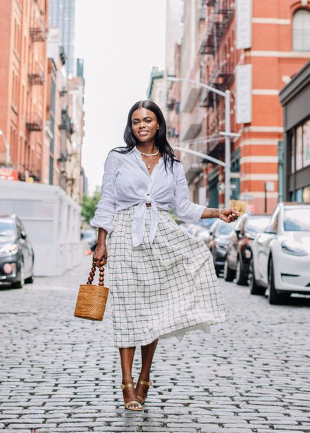 Mad for summer plaid @anthropologie  Yes summer plaid is a thing and you can find it in this Corey midi skirt.  Wearing a size small