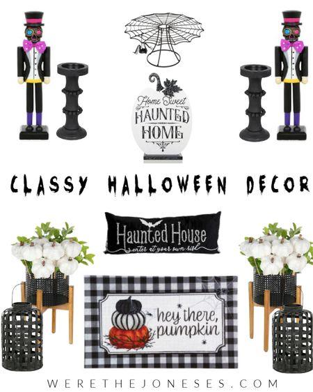Classy Halloween decor for your haunted home 🕸💀  . . Halloween decor, fall decor, skull, black and white, pumpkin, sugar skull, pillows   #LTKHoliday #LTKhome #LTKSeasonal