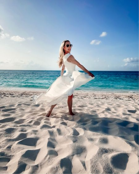 A floaty white gown makes the perfect destination wedding dress. One shoulder wedding gowns are in for 2021 and some of these are in the Nordstrom Anniversary Sale🤍  📍 @sevenstarsresort 👗 @macduggal . . .  #gracebaybeach #tci #nsale #providenciales #turksandcaicos #luxurytravelblogger #macduggal #nsale #luxurytravel #instatravelgram #sevenstars #sevenstarsresort #destinationwedding   Follow my shop on the @shop.LTK app to shop this post and get my exclusive app-only content!  #liketkit #LTKwedding @shop.ltk http://liketk.it/3kQJI  #LTKsalealert #LTKtravel #LTKwedding