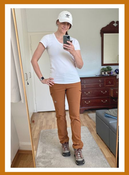 """Here are some more of my favorite hiking attire 🥾   ➡️ these PANTS are amazing!  I have them in 3 different colors. The burnt orange is from last year, but they have several other fantastic colors to choose from.  These pants are light weight, with awesome stretch for moving around, ☔️ water repellent and  come in a 35"""" inseam 🙌  ➡️ I have posted the tank top version of this TOP before.  Yes it says maternity on the label, but this is one of my favorite go to t-shirts.  Heavy weight, not see through and LONG!  ➡️ everybody needs a good pair of hiking boots 🥾 and I'm in ❤️ with Merrill's!  They are so comfortable and have good arch support.  Now I just need the low top version 😉   #LTKtravel #LTKshoecrush #LTKSeasonal"""
