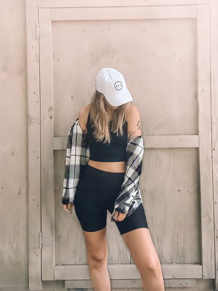 Black biker shorts with a black crop top and a plaid black and white shacket make for a great transitional outfit from summer to fall! Shacket and crop top are a small and biker shorts are a size medium!  #LTKstyletip #LTKfit #LTKunder50
