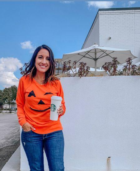 Grown up Halloween 🎃 sweatshirt.  Halloween sweatshirt, jeans, and a side of coffee.  Sweatshirt is cozy and perfect for pumpkin season    #LTKsalealert #LTKunder50 #LTKHoliday
