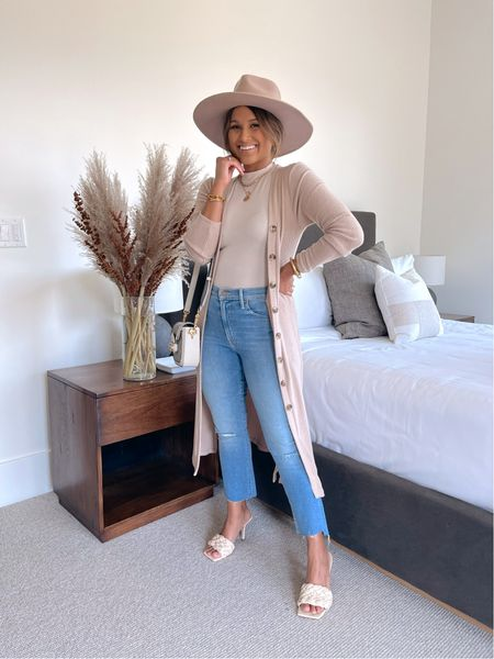 """You can now shop my fall 2021 collection I designed with @gibsonlook that includes this Duster Cardigan Sweater with Side Slits  I'm wearing in """"Cuban Sand""""  Code: HAUTE15 for 15% OFF!  Sizing: Size up if you want to wear it as a dress or top!  Notes: This super comfy cardigan is so versatile you can wear it 3 different ways! Wear it as a dress or just button the top 3 buttons to wear it as a top over leggings or jeans, and lastly wear it open as a cardigan as you see here! It also comes in """"Black"""" & """"Turmeric""""  #fallfashion #falloutfit #ribbedcardigan #cardigandress #cardigantop #whitebodysuit #highwaistedjeans #fallhat #blackdress #designerbag    #LTKstyletip #LTKunder100 #LTKsalealert"""