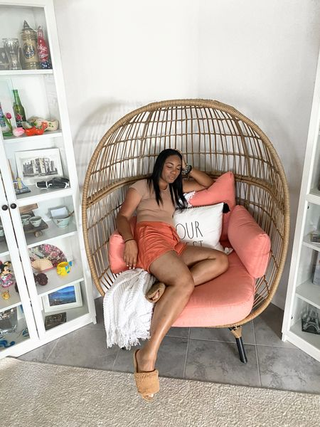 Can't get enough of this egg chair! Shop the look! #eggchair #decorchair #bamboo #bamboochair #whiteshelfunit #displayshelf  #LTKstyletip #LTKhome