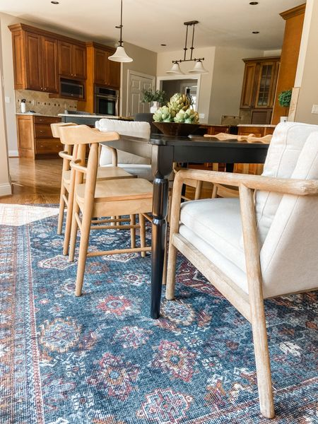 These Target blonde wood dining chairs look great with the black dining table.  Dining chairs, dining room decor, area rug, mix and match dining room, home decor, Loloi rugs  #LTKhome