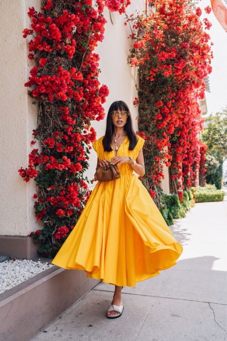 Obsessed with this statement voluminous yellow dress! Perfect for our weekend getaway to Monterey. Paired it with neutral leather slides and Bottega Veneta clutch. Linking to this exact dress as well as a few other options I'm loving   #LTKstyletip #LTKitbag