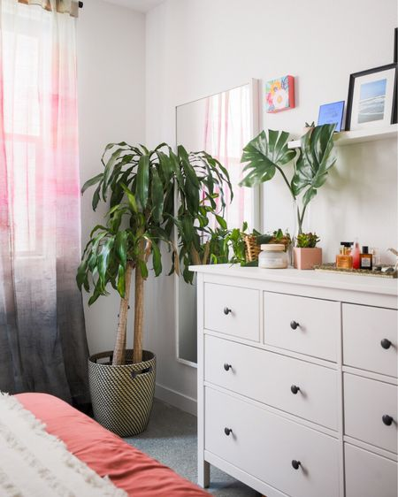 """Happy Tuesday! Its time for a midday story because you know I've been trying to be the plant lady. 😂 These warmer temps have been a challenge indoors too, because I don't want to make the house too cold for my plants (or have the vent blowing on them). You see the plant in the corner? She's been alive for YEARS and she is my favorite. Technically, she's not even mine. She was in CJ's apartment before, made it to our house, and when I moved out, I took it. I had to! This time last year was rough. I was struggling with my purpose in a major way, not feeling like enough, and couldn't turn a corner. Getting up and """"going after it"""" was wearing on me, and when CJ would leave for work, I would be working from home, but struggling. But! I had a routine. I'd check this lady's soil, water her if necessary, rub the leaves and talk to the plant, admiring the growth or sharing my intention for the day. I'm happy I've kept her alive. I thought she wasn't going to make it when I moved, but over the past couple of months, she's really been blooming again. She and I have a lot in common. #newthingsonthehorizon #athomewithkachet #chezkachet 📷: @nicolediannephoto   http://liketk.it/2Etsv #liketkit @liketoknow.it"""