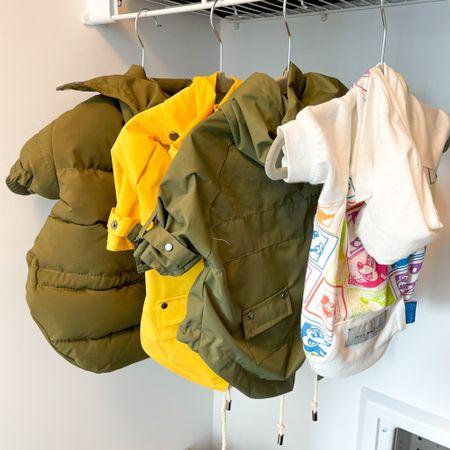 Dog mom hack: hang up your small dog's clothes using baby hangers. I found cute grey velvet hangers on Amazon!   Organized space, storage, closet, dog mom, raincoat, spring cleaning #LTKhome #LTKdog #liketkit @liketoknow.it http://liketk.it/38ESz