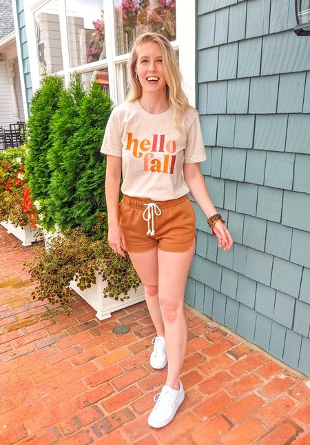 Hello fall!!! 🍂🎃 I've been waiting to share this fun Pink Lily graphic tee for everyone who was still holding onto summer. But now it is 𝘰𝘧𝘧𝘪𝘤𝘪𝘢𝘭𝘭𝘺 fall and I am so excited! And these super soft shorts are from Target for only $12! 😱 Paired with my white Nike sneakers.   #LTKSeasonal #LTKstyletip #LTKunder50