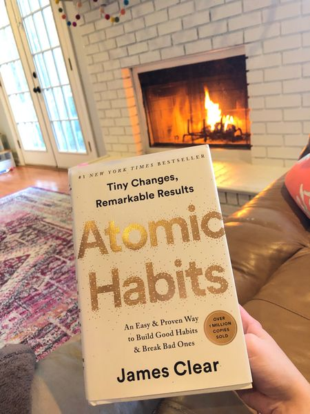 Cozied up by the fire reading Atomic Habits. Such an amazing self help book! #bookwork #atomichabits #fireplace #mama #mompreneur   #StayHomeWithLTK #LTKSeasonal #LTKhome