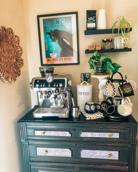 Honestly!!! I'm in LOVE with my coffee bar! I'm a cat lady at heart and I just had to go with this theme. If you create your own little slice of heaven then just go with your own vibe. I've linked almost everything in the photo down to the adorable coffee sleeves I stamped myself. I bought hot and cold to-go cups so I can make and take my own drinks on the road. It's been amazing AND the money I'm saving is a 𝗟𝗔𝗧𝗧𝗘! (Sorry, I had to do it) ☕️ . . .  Download the LIKEtoKNOW.it shopping app to shop this pic via screenshot   OR follow the LIKEtoKNOWit link in my Instagram bio ❤️  http://liketk.it/3aF6J #liketkit @liketoknow.it #StayHomeWithLTK #LTKhome  #coffeebar #makeyourowncoffee #lattes #espressomachine #coffeemugs