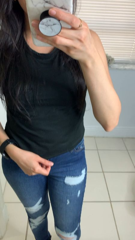 Crop top, ripped jeans, and combat boots look. These black boots are under $40 and it's also available in brown color. I also wear my Fitbit Versa watch to track my sleep and daily steps.   #LTKtravel #LTKunder50 #LTKshoecrush