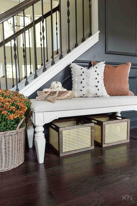 Just a few seasonal touches brought fall to my entryway. Home decor fall decor foyer decor cane crate fall pillow plant basket padded bench  #LTKSeasonal #LTKhome #LTKunder50