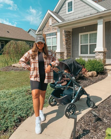 """Mom's August uniform: biker shorts, compression tank, baseball cap + flannel 🍂☀️ Linking my outfit, stroller, diaper bag and must have stroller accessories on the @shop.LTK app.  Screenshot this post and then head over to the """"❤️"""" section in the LTK app to get all the details! #liketkit #LTKfamily #momlife #stroller #falloutfit #amazonfashion #mommin #toddlermomlife #realmomstyle #mommyblogger #uppababy   #LTKfamily #LTKbaby #LTKSeasonal"""
