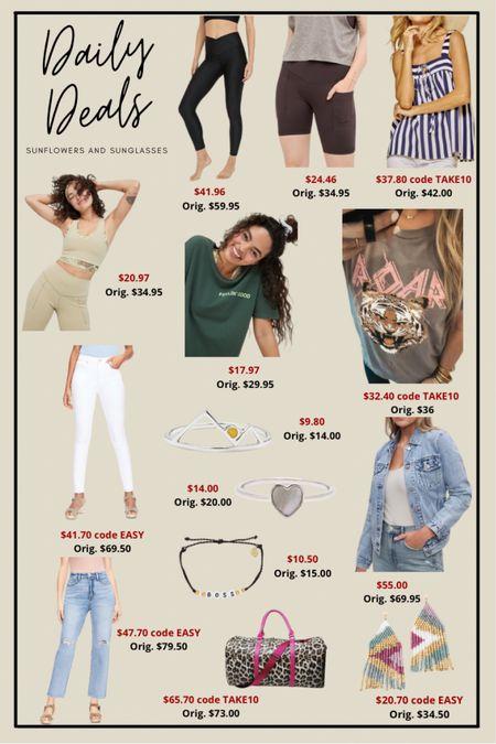 Athleisure, striped tank top, graphic tees, white jeans, jean jackets, silver rings, boss bracelet, leopard duffle bag, beaded earrings  #LTKsalealert #LTKunder100 #LTKunder50