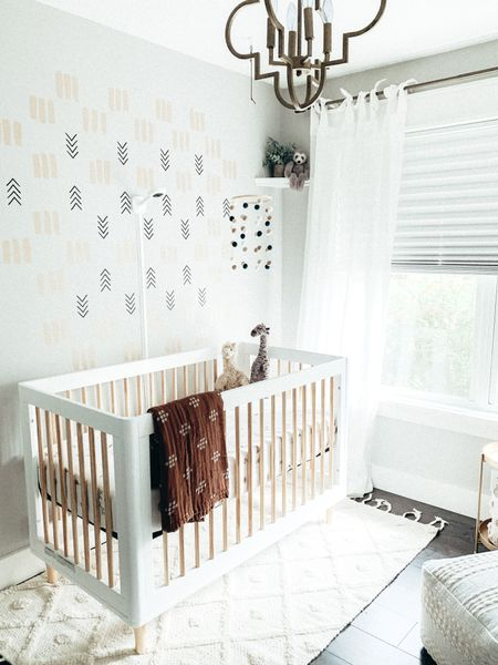 Another view of our nursery for baby #2! I love the look of this Babyletto crib from Crate & Barrel. Shop the nursery decor and all the details: http://liketk.it/2XjFn #liketkit @liketoknow.it @liketoknow.it.home #LTKbaby #LTKkids #LTKhome