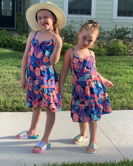 These $8 summer dresses from target are perfect for travel or a day at the park! They have a few different pattern options, too! Love these for Memorial Day and pool swim days! Their shoes are Walmart finds!  http://liketk.it/3gg23 #liketkit @liketoknow.it #ltkseasonal #competition #LTKkids #LTKtravel #LTKswim