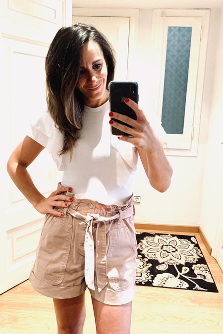 http://liketk.it/3fXUM #liketkit @liketoknow.it @liketoknow.it.home #LTKbeauty #LTKstyletip  Weekend vibes when the sun is shining!  Pink paper bag shorts  White body suit puffed sleeved  Gold ring  Gold earrings  Black wedge sandals
