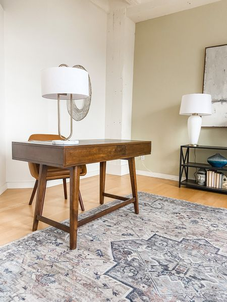 Mid century modern desk with a vintage inspired are rug.  Office style, home office, wood desk, loft decor, work from home, desk ideas  #LTKhome