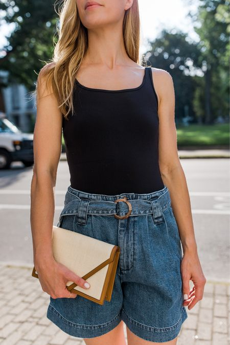 My top ten summer essentials are live on natalieyerger.com! Tailored shorts and a tank top (this is actually a bodysuit) are two of the 10. Throw on heels or sandals, and you're ready to go. My envelope clutch is Hunting Season—I have two of their bags, and while a splurge, I recommend them as a long-term closet staple! They're so discrete and have no branding.   black bodysuit, Abercrombie bodysuit, sleeveless bodysuit, tank top bodysuit, jean shorts, belted jean shorts, paperboy shorts, bodysuit with shorts, casual summer outfit, envelope clutch, hunting season bags, cellajaneblog, cute summer outfits   #LTKDay #LTKSeasonal #LTKunder100