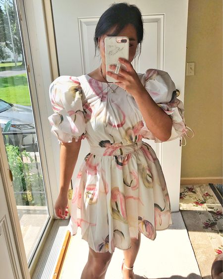 such a statement dress! The dramatic puff sleeves screams drama and LOVE the print. Super girly, romantic and fun - the back is also open😍 http://liketk.it/3jIns #liketkit @liketoknow.it #LTKunder100 #LTKstyletip #LTKwedding