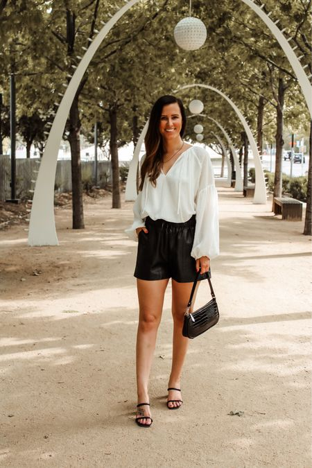 It's faux leather shorts season y'all! 🖤 I wore these babies all last fall and I can't wait to style them again this year. They are under $30 and in my opinion must have fall item!  •
