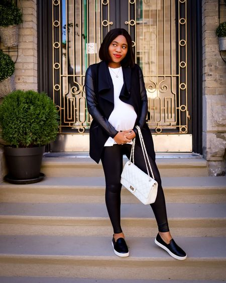 Simple black and white maternity look wearing comfy faux leather leggings and stylish drape front jacket. Tagged exact bump style pieces for you. Wearing a medium in the pants and small in the jacket & white tee. Follow me for more fashion finds.💋  #LTKbaby #LTKbump #LTKstyletip