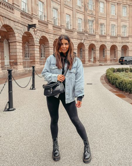 Autumn outfit Denim jacket All black hoodie and leggings outfit Dr marten boots Coach tabby pillow