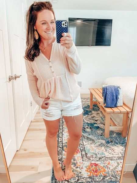 Friday Payday today at Pink Lily means 20% off! This top is a must have in every color! Lightweight waffle texture pairs perfectly with shorts, leggings, or your favorite jeans. Use code TGIF! #ltkseasonal #ltkmama #pinklily #henleytop #whiteshorts #nickelandsuede #corkearrings #transitiontop