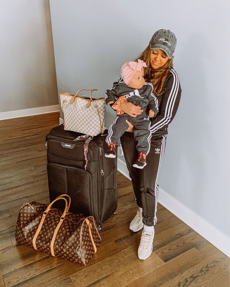 Mama and me. Adidas tracksuit. Baby girl. Toddler girl. Mommy and me. Luggage. Travel outfit. Mom style. Travel style. Nike shoes. Baby shoes. @liketoknow.it @liketoknow.it.family http://liketk.it/3jSa5 #liketkit #LTKbaby #LTKfamily #LTKtravel