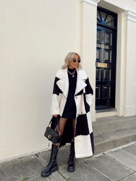 The dreamiest black and white check premium faux fur coat styled with a black roll neck, black mini skirt and spot tights and chunky boots for one of my go to ways to styled oversized statement coats for the autumn/ winter months! - if a coat is extra I always style it as the focus piece and layer over neutral pieces to allow it to stand out!   #LTKstyletip #LTKeurope #LTKSeasonal