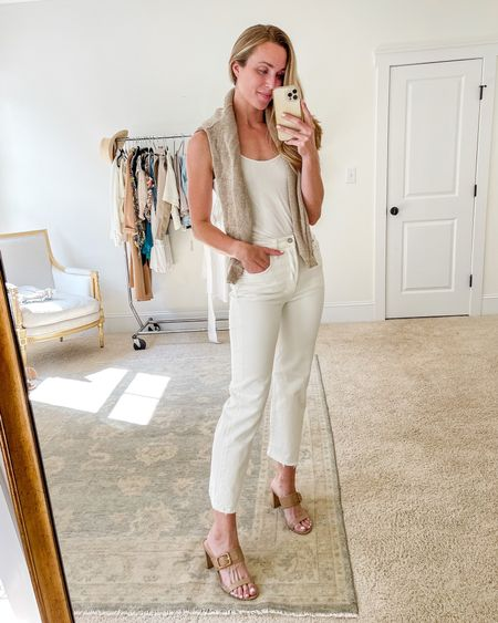 All white outfit for the end of summer 🤍 Sweater and tank are old (similar linked), and these white jeans and buckle heels have been my favorites to wear for date night all summer! Both run TTS. #allwhiteoutfit #whitelevis #heeledsandals
