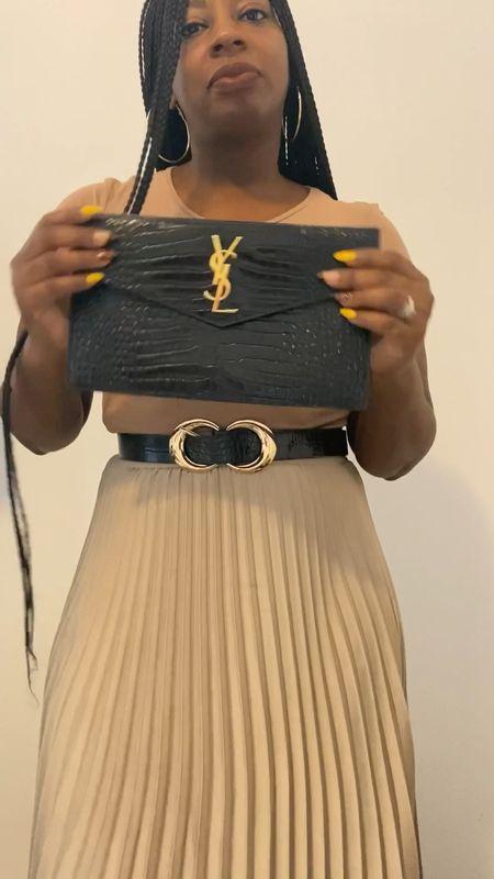 Here's how to transform your clutch into a handbag in under 5 minutes!   #LTKSeasonal #LTKstyletip #LTKunder50