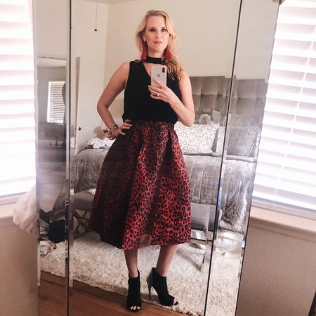 I don't know about you guys, but I can't get enough of leopard print this season! You wouldn't believe the price tag on this statement skirt (under $20) - it's so fun for girl's night out! Shop my entire look via my bio or with the @liketoknow.it app! http://liketk.it/2xNba #liketkit  #LTKunder100  #LTKunder50 #asseenonme #leopardprint #rewardstyleblogger #texasblogger #mirrorselfie #fallstyle #styletips #falloutfit #momblogger #sanantonio #midiskirt