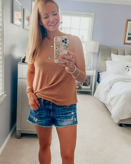 I am going  to live in this tank from LAMade clothing. It's so soft, comfortable and the color is perfect heading into fall. Wearing a size S. Fits TTS. Perfect with jean shorts now and jeans + a cardigan later. #LTKstyletip #LTKunder100 http://liketk.it/3jPag #liketkit @liketoknow.it Shop my daily looks by following me on the LIKEtoKNOW.it shopping app.
