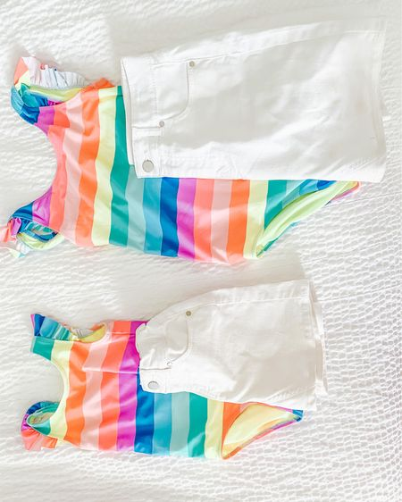 These rainbow one piece swimsuits are sold out from H&M but I linked the two piece version and the denim skirt the girls wore over them. Comes in white and blue denim!   http://liketk.it/3eEGN #liketkit @liketoknow.it #LTKfamily #LTKkids #LTKswim