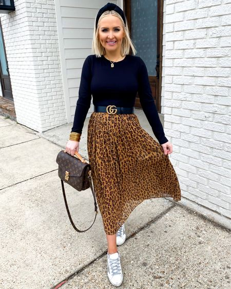 Bump friendly leopard midi skirt with Golden Goose sneakers! Maternity style, pregnancy style http://liketk.it/38aqt @liketoknow.it #liketkit #LTKbump