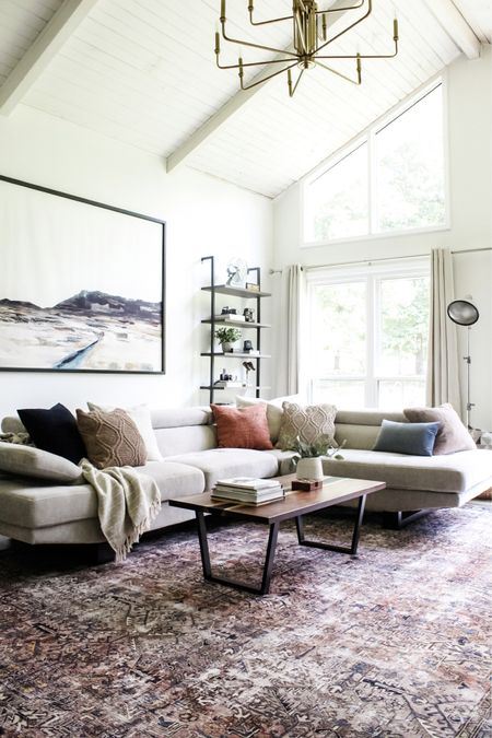 Our living room remodel is almost done, and I can't believe how different it looks! The painted white vaulted ceilings brightened it up so much! And the tall bookshelves and oversized art take it to the next level.