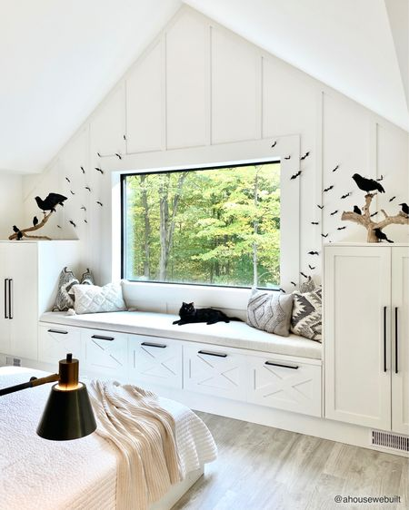 """Our bedroom window seat is ready for Halloween! Building this was one of my favorite projects we did this year - it added so much storage and function to this space and totally feels like it completed the room! We documented the whole process and shared it on our website's """"Tutorials"""" section (including making no-sew window seat cushion)."""