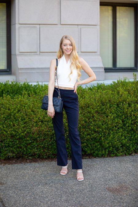 Navy and white look for summer White halter top with tie back Linen blend navy pants White slide sandals Chanel navy trendy    #LTKitbag #LTKstyletip #LTKSeasonal