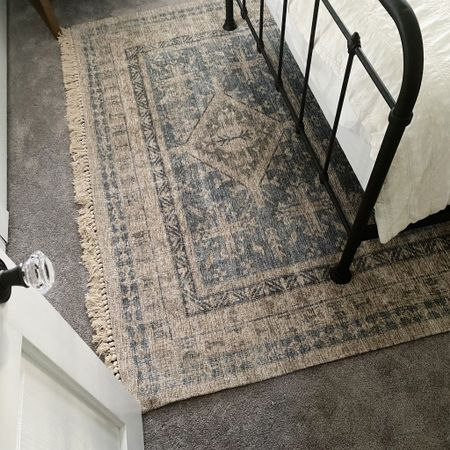I love how layering this area rug over my carpeting helped define the space!