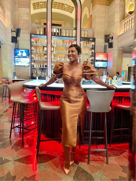It's #weddingseason and this brown gold puff sleeve midi dress and nude pumps is a great #weddingguest look #christianlouboutin   #LTKSeasonal #LTKstyletip
